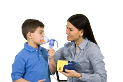 Child using Bubbles the Fish nebulizer mask
