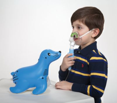 Kid using Sami the Seal nebulizer machine