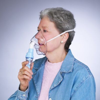 Woman using sidestream nebulizer mask