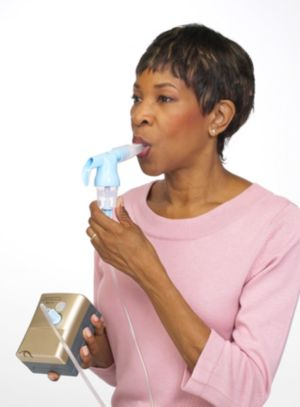 Woman using nebulizer